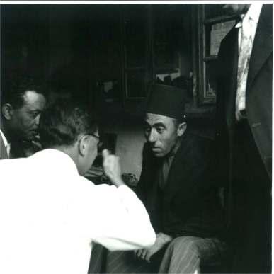Khalil Iskander Shahin (Kando) in his Bethlehem shop, c.1956.