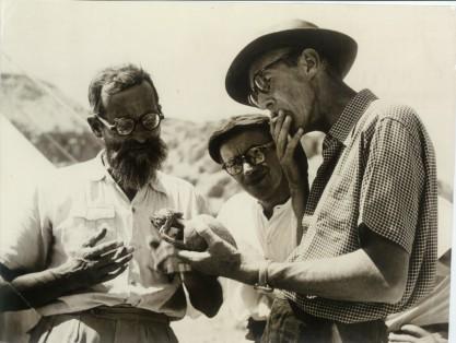 Roland de Vaux, J. T. Milik and Gerald Lankester Harding examine a sealed juglet, Qumran (1956?)