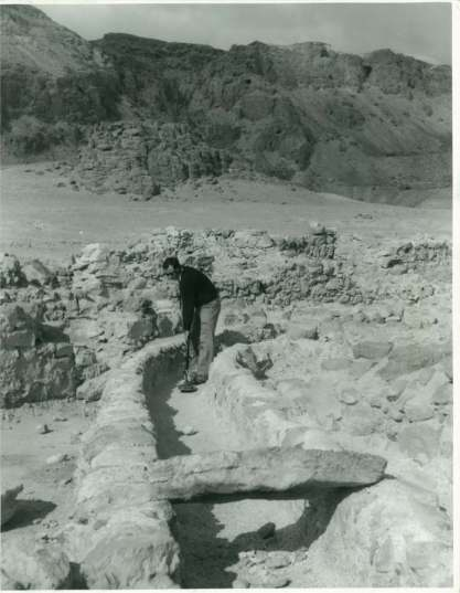 Man working with metal detector on Qumran water channel (1956?).