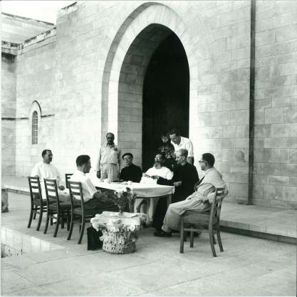 Dead Sea Scrolls team at the Palestine Archaeological Museum, from left, Fr. Pierre Benoit, Claus-Hunno Hunzinger (seated), Yusef Saad (Director of the Palestine Archaeological Museum), Josef Milik, Roland de Vaux and Jean Starcky, with Allegro standing behind, and Joseph Fitzmyer The photo was taken when Hunzinger in the team. The photo was taken 1 October, 1956. We are grateful to Alexander Schick for additional information for this caption.