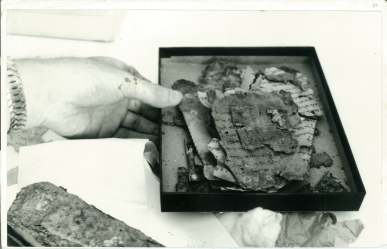 Box of 11Q materials with Psalms Scroll roll at bottom right: 5 September, 1957.
