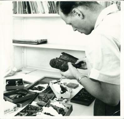 Copy of JMA 8 hunzinger examining scrolls 11Q