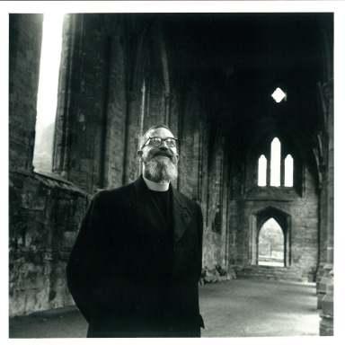 Fr. Roland de Vaux visiting a church ruin, England. 1960s.